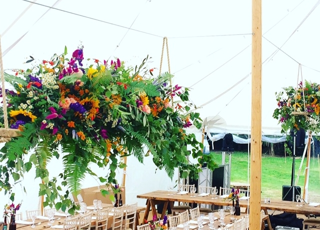 Hanging floral arrangement, wedding flowers, Floral swing, Sunflowers, Vibrant summer wedding flowers