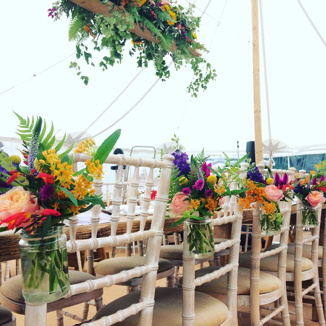 chair flowers, aisle flowers, pew ends, vibrant floral jam jar