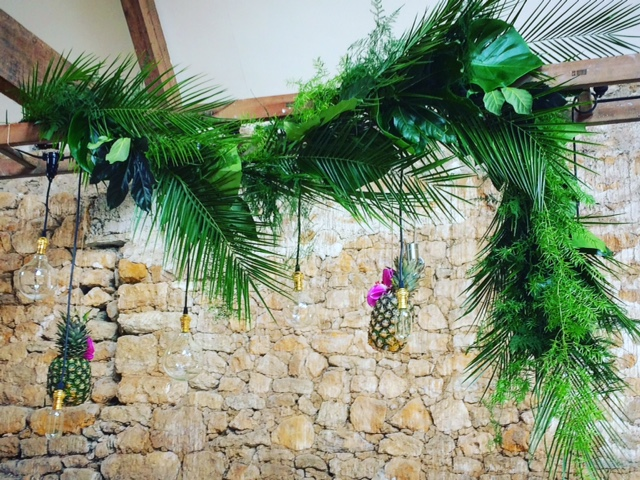 hanging foliage ladders with pineaples and eddison bulbs wedding Dorset