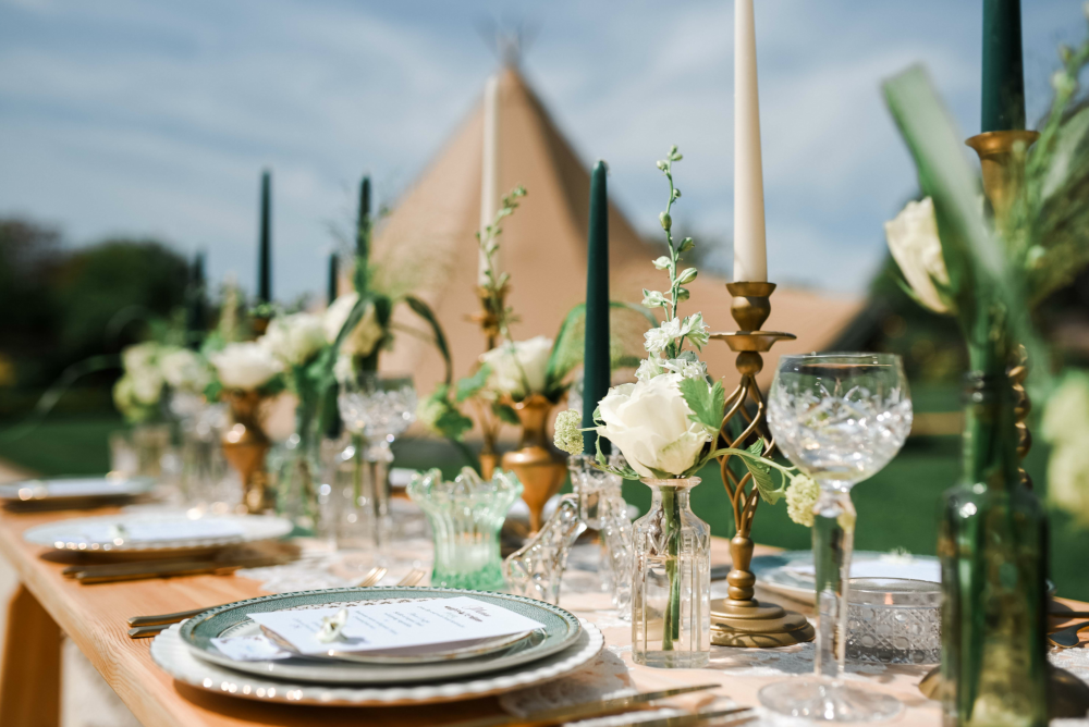 coastal tents tablescape candles flowers candle sticks crystal