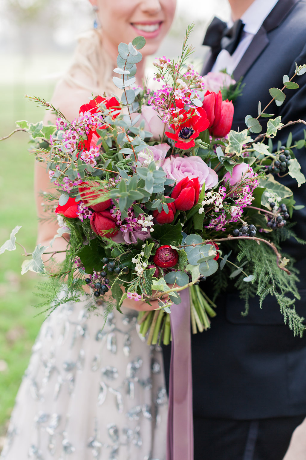 Red tulips, red anemone, lilac rose, eucalyptus, ferns, textured foliage, spring brides bouquet