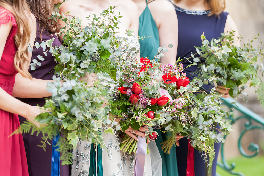 All foliage bridesmaids bouquets, red tulip, red anemone, lilac rose, spring brides bouquet, woodland foliage, ivy, ferns, eucalyptus