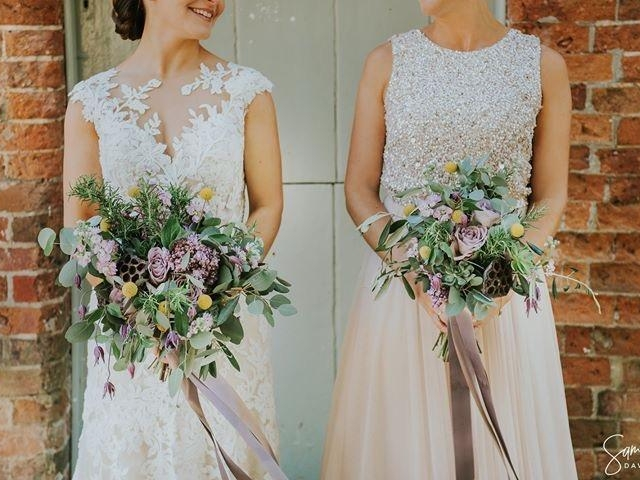 Rustic foliage bouquets with lilac rose, lotus pods, scented stocks, foliage, craspedia, bride and bridesmaids bouquets