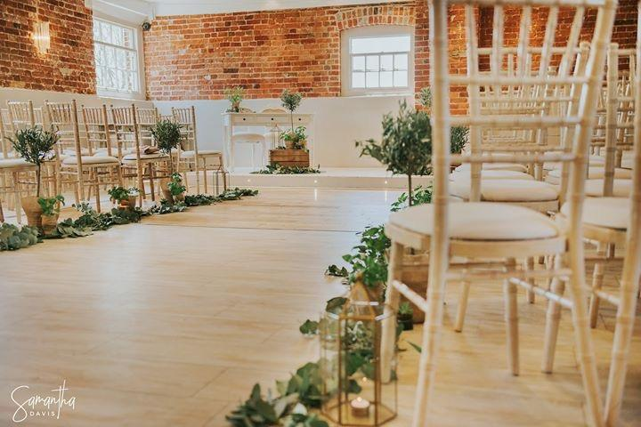 Olive tree aisle decorations, herb plants, foliage, gold lanterns, tea lights sopley mill wedding