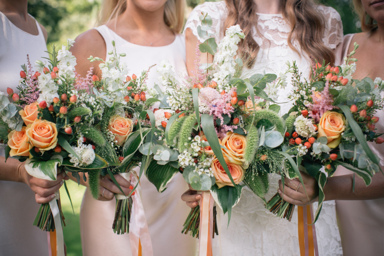 Textured foliage peach rose bridesmaids bouquets
