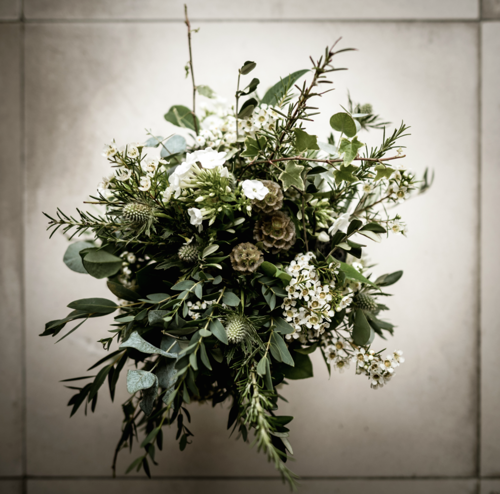 All foliage rustic bridal bouquet with dainty white flowers and seed heads