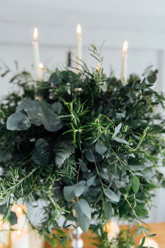 Rustic foliage candelabra arrangement weddings - table centrepiece - herbs - ferns - eucalyptus