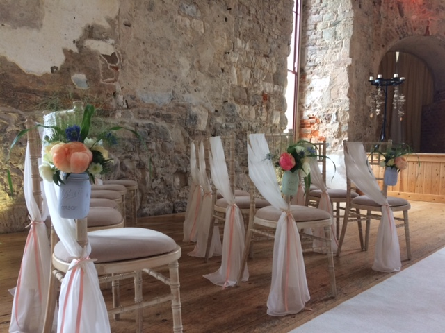 Lulworh castle-pew ends-aisle decorations-jam jars-mason jars- ceremony flowers