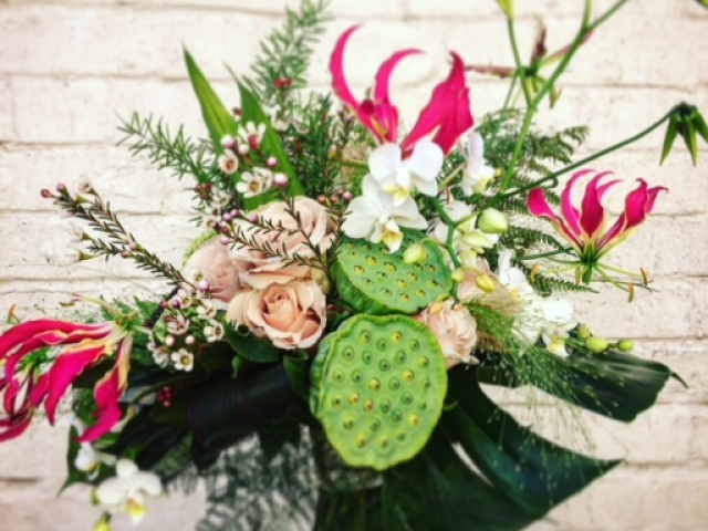 Textured foliage and tropical flower bridal bouquet