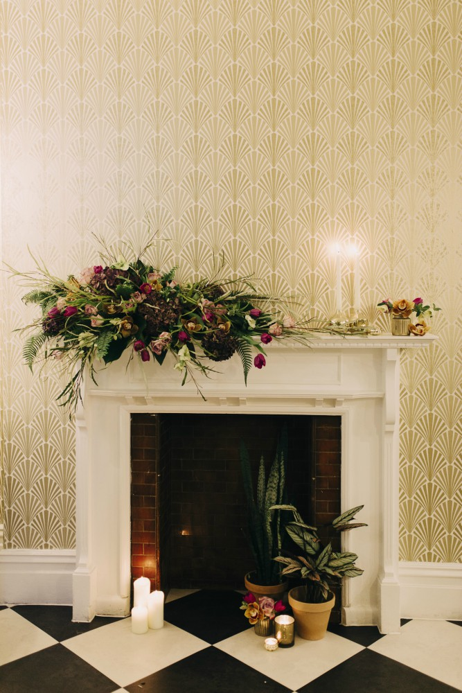 Candlestick, floral jam jar, fireplace, wedding flowers