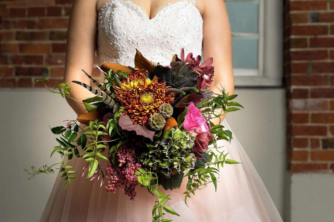 Moody textured autumn bridal bouquet, wedding bouquet, orchids, rose, hydrangea, rustic bouquet, rustic wedding, feathers, foliage, seed heads