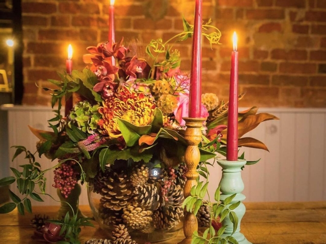 Sopley mill candle and autumn table centrepiece, rustic, vibrant, foliage, candlestick