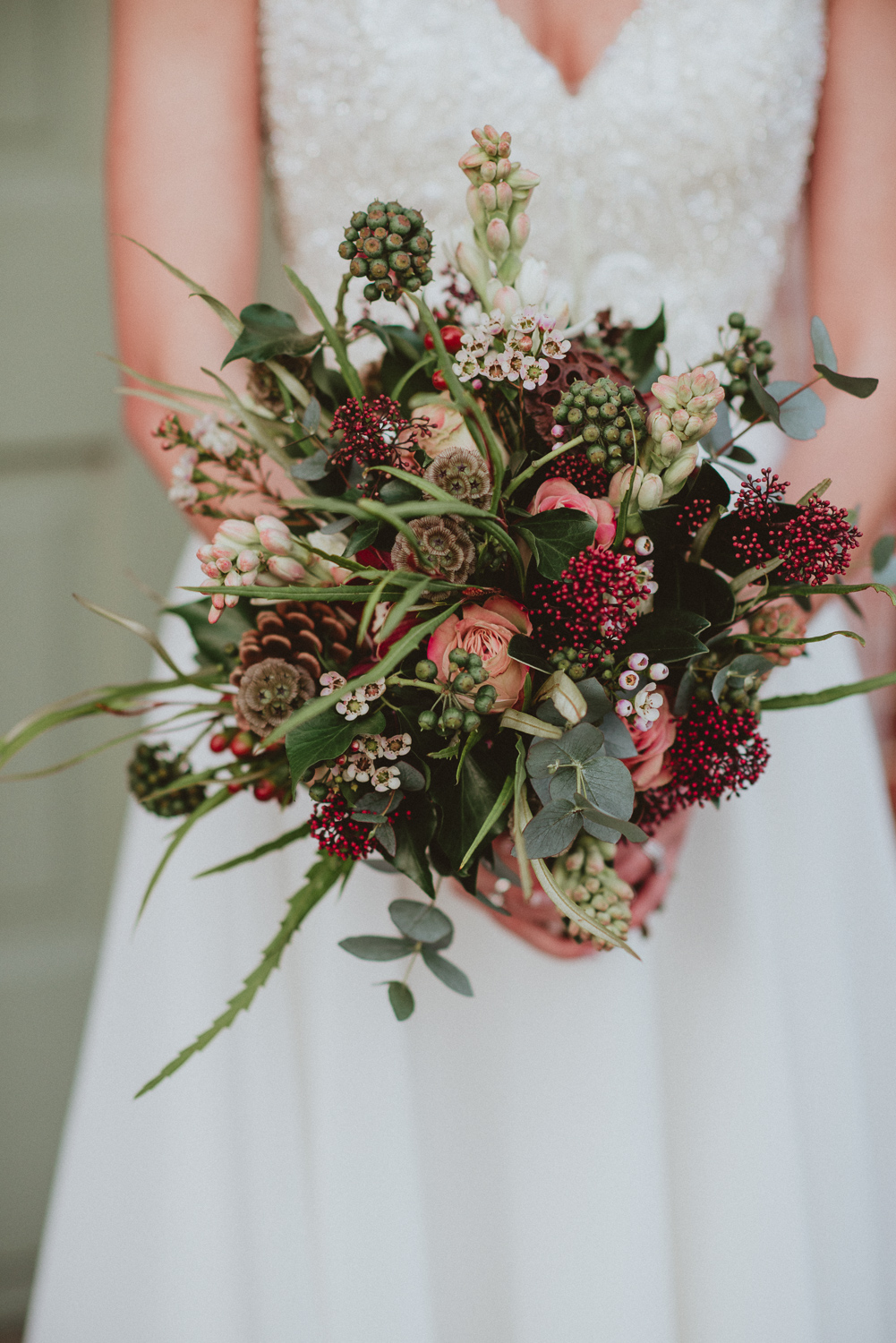 Winter wedding bridal bouquet, nude rose. seed heads, pine cone, rustic flowers