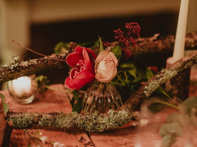 Rustic tree branch, rose, orchids, candles, tea lights, candle stick, tablescape, table centrepiece, winter wedding flowers