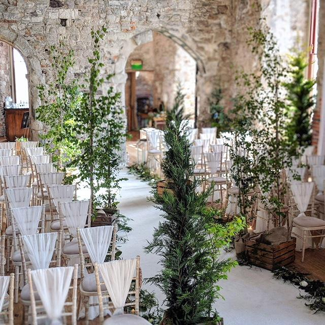 Birch tree woodland wedding aisle, lulworth castle, wedding ceremony, twiglight wedding. wedding flowers, dorset