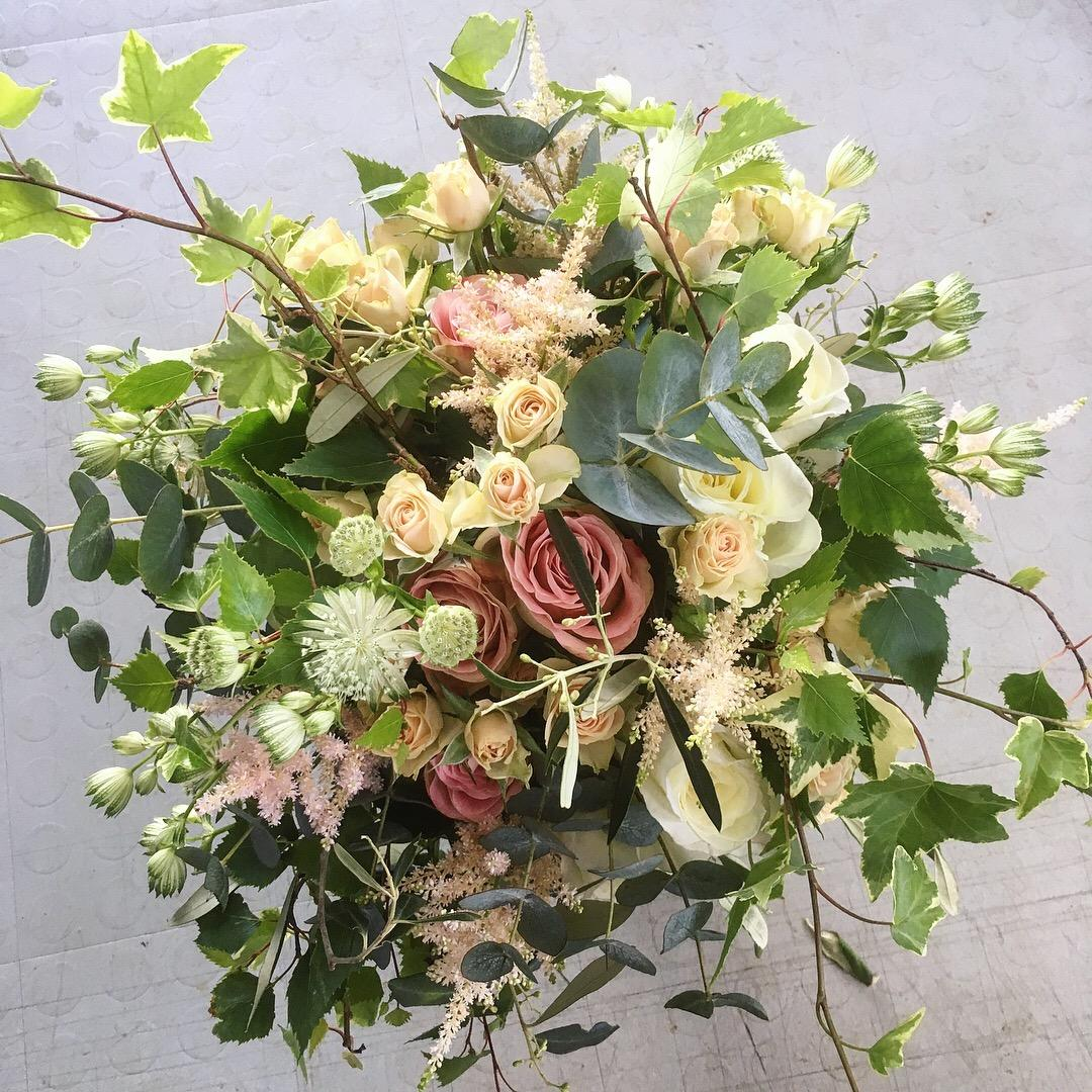 Garden rose bridal bouquet with foraged foliage