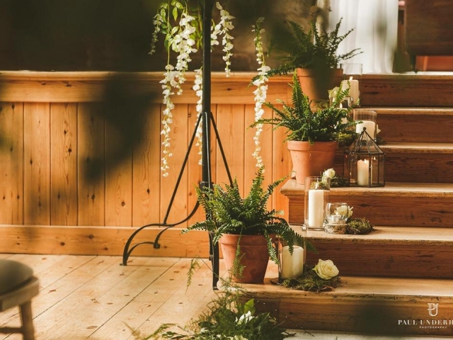 Fern plants and candles, moss and roses, lulworth castle wedding ceremony, wedding flowers, dorset