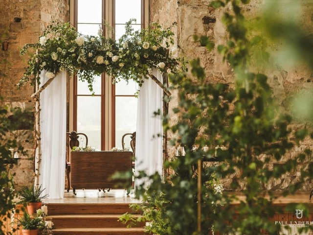 Royal wedding themed foliage arch. green and white flowers, foliage, lulworth castle wedding ceremony, wedding flowers dorset