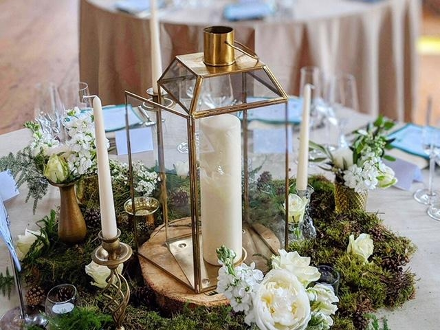 twilight woodland wedding table centrepiece, gold lantern, moss, lulworth castle wedding. dorset
