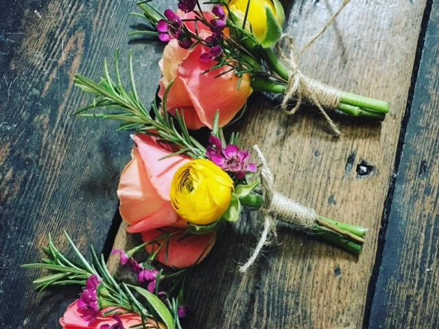 Rustic coral rose and mustard yellow buttonholes. old vicarage, Dorset