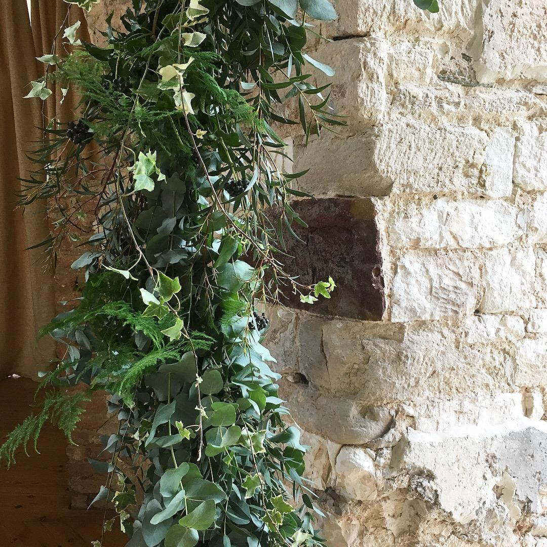 Ivy. euclayptus, fern, foliage moon gate lulworth castle, ceremony, wedding arch