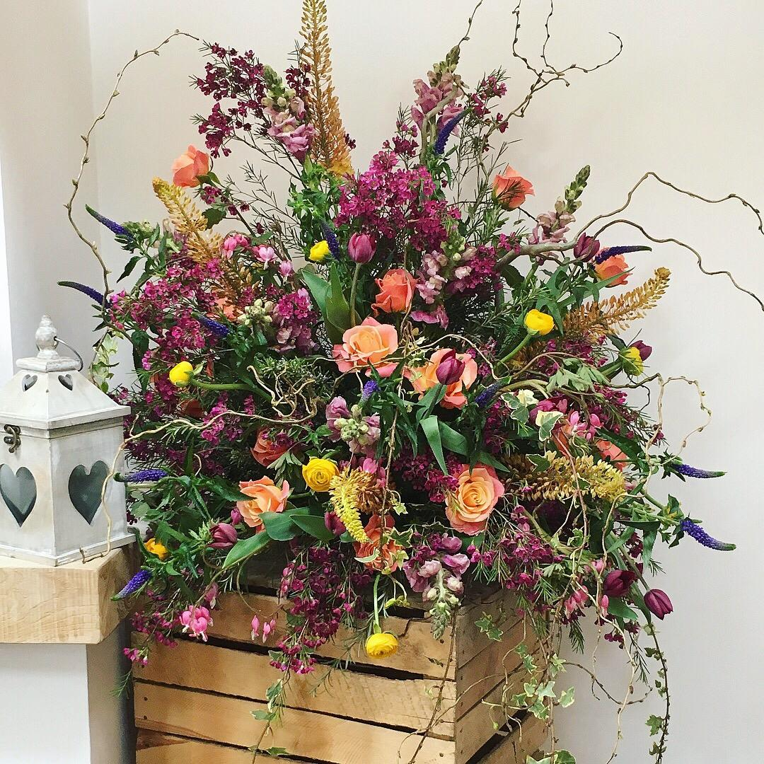 Rustic. wild. garden flower, vibrant, coral, yellow, pedestal arrangement, wedding ceremony flowers