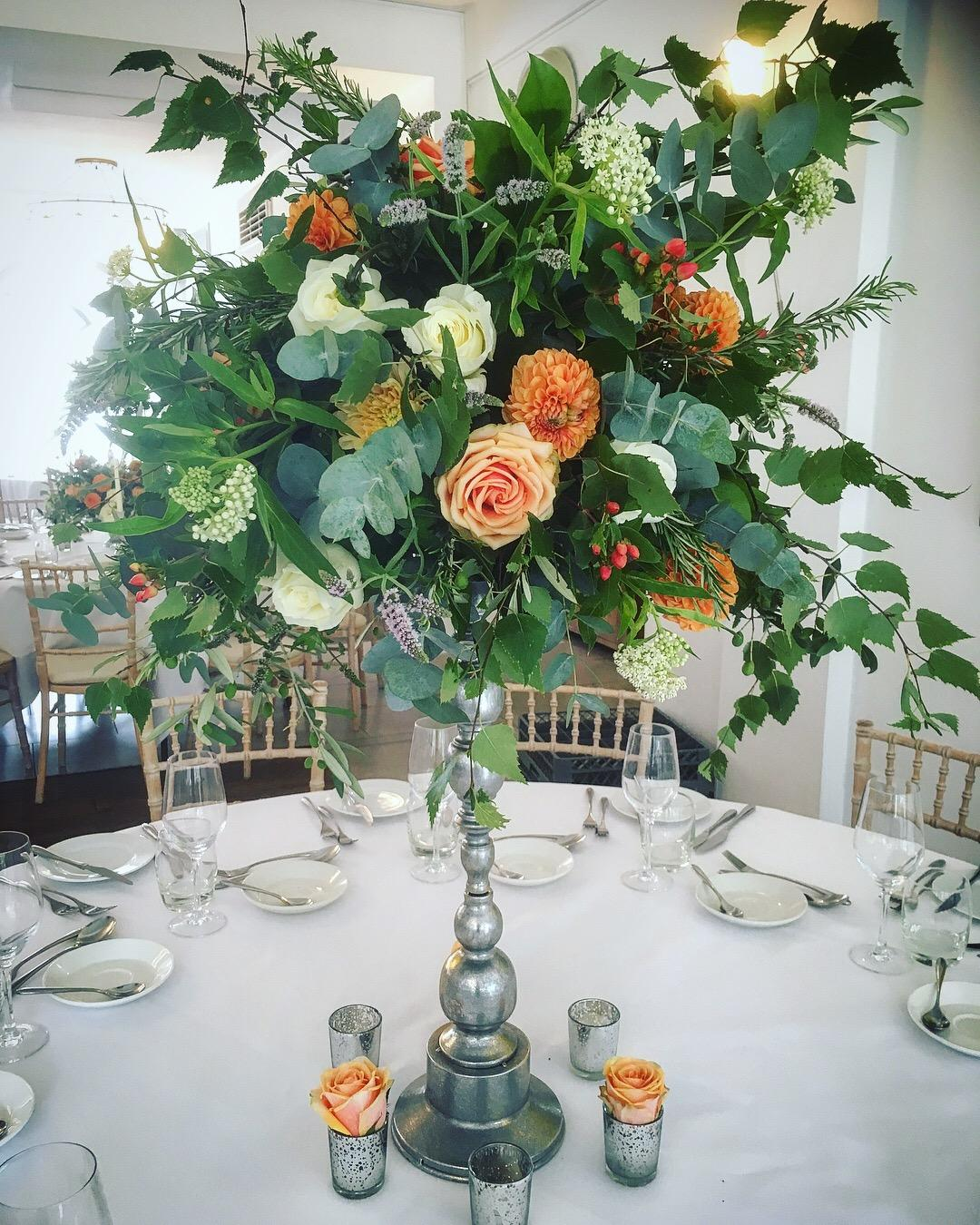 TALL SILVER CANDLESTICK TABLE CENTREPIECE WILD FOLIAGE ARRANGEMENT ORANGE PEACH FLOWERS WEDDING ITALIAN VILLA