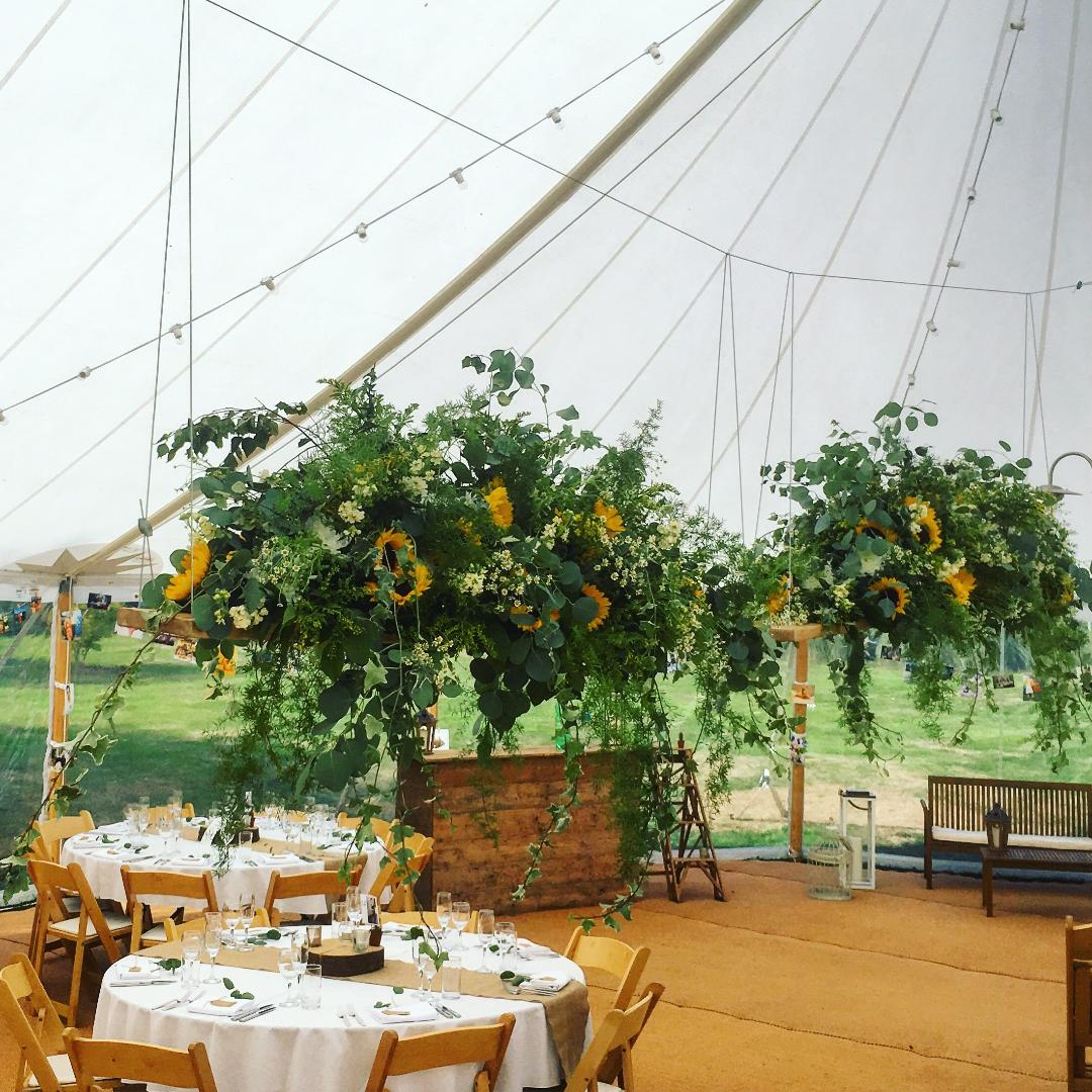 Boho summer wedding, sunflower and foliage floral swing, hanging flowers, marquee wedding, Dorset