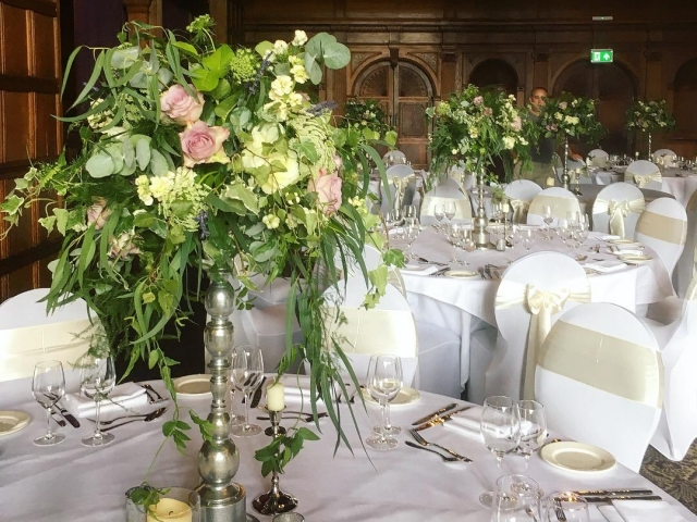 Tall silver candlestick table centrepiece, wild foliage arrangement, woodland wedding, wedding flowers, rustic wedding flowers, rhinefiled wedding, Dorset