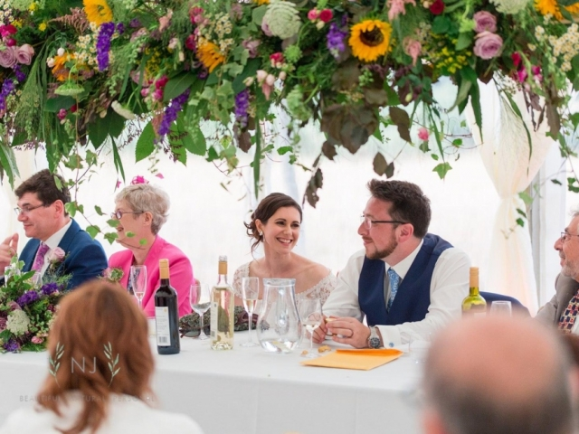 TOP TABLE, BRIDE AND GROOM, WEDDING DAY, MARQUEE WEDDING, HANGING FLORAL GARDEN, FLORAL SWING, WEDDING FLOWERS, DORSET, HAMPSHIRE