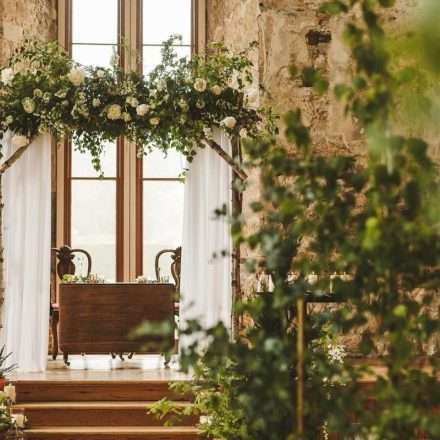 lulworth castle woodland wedding ceremony trees floral arch green and white