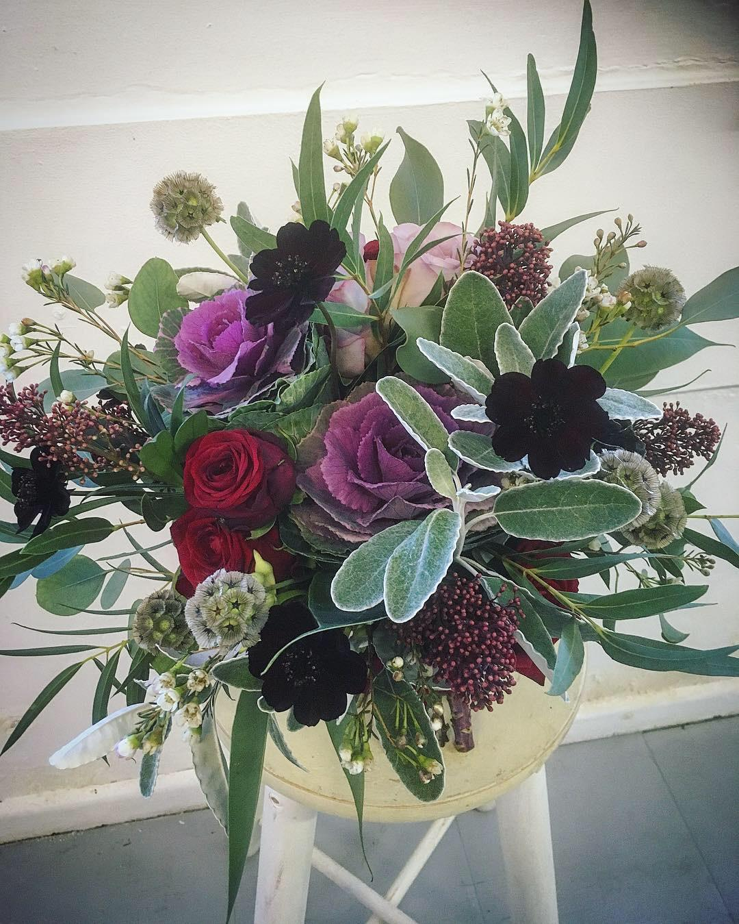 Winter wedding bridal bouquet, black cosmos, red rose, purple cabbage, rustic bouquet