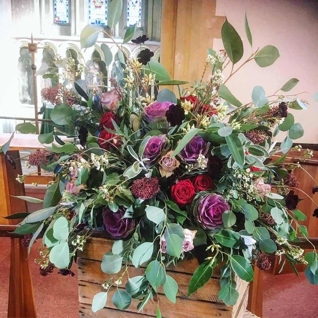 Church flowers, pedestal flowers, large floral arrangement, rustic arrangement, winter wedding flowers, wild unstructured wedding flowers