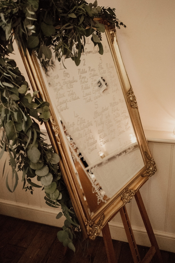 Wick Farm wedding New years eve gold mirror table plan foliage garland