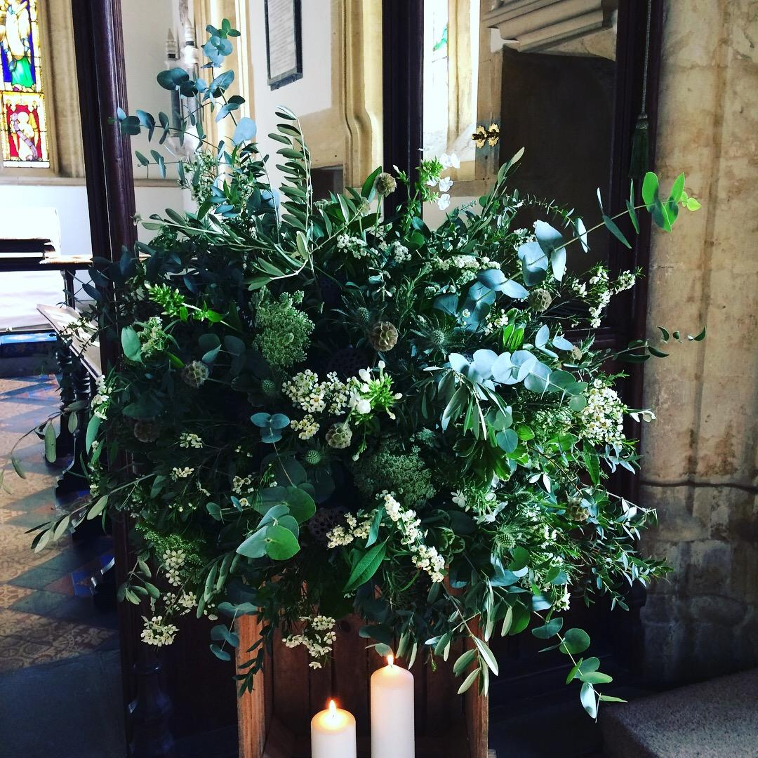 Rustic wooden crate floral arrangement, ceremony flowers, church flowers, white flowers, foliage, pillar candles, wedding flowers, Axnoller, Dorset