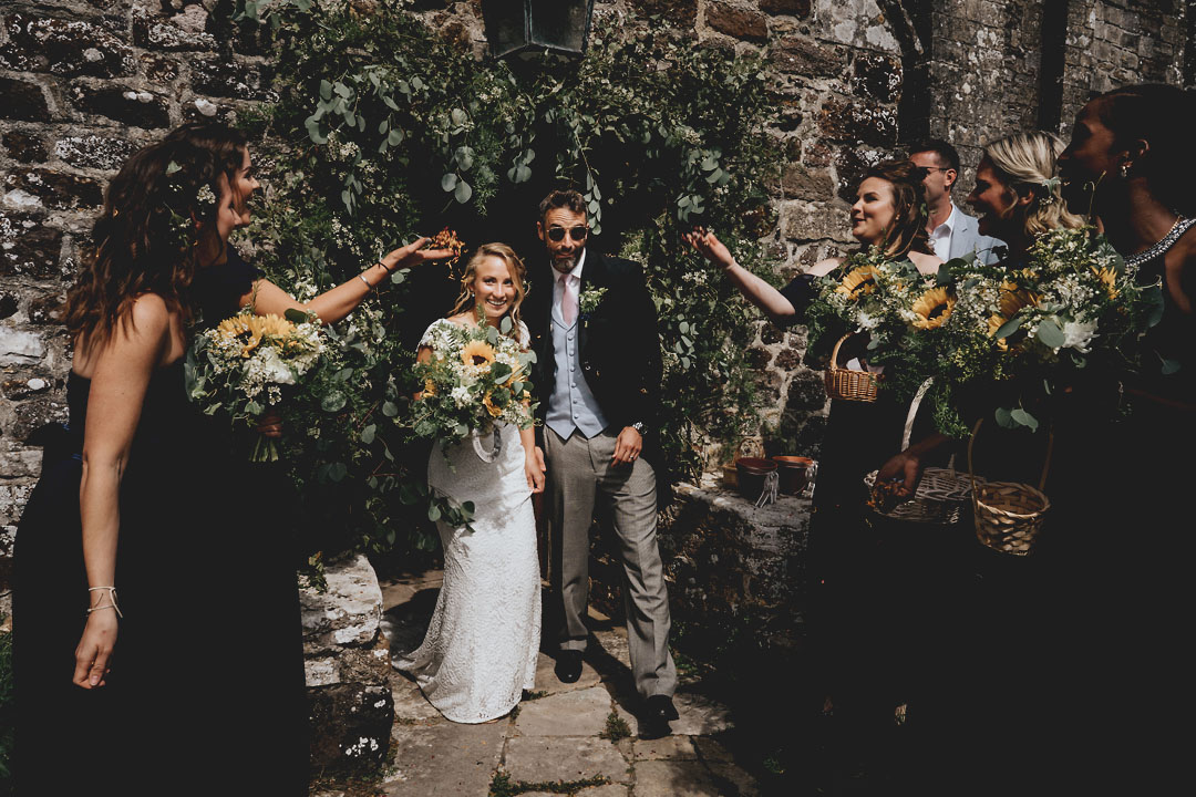 St Nicolas church studland foliahe arch church wedding wedding flowers sunflowers