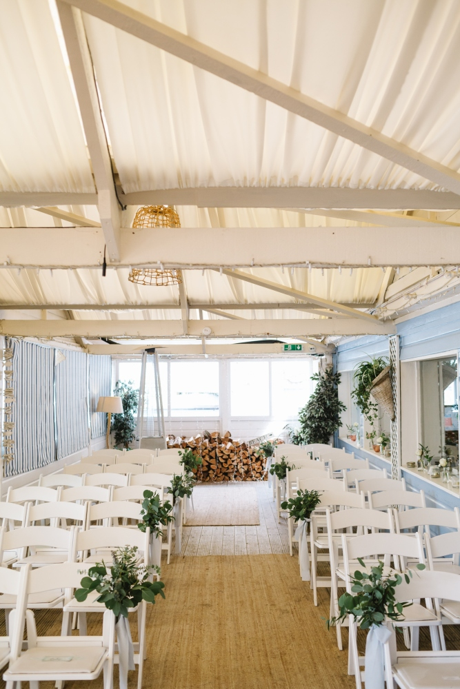Eucalyptus foliage aisle decoration, pew ends, beach wedding cornwall