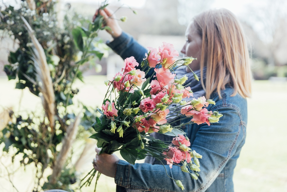 Florist at work. floral installation, wedding florist, Dorset, Hampshire, moongate