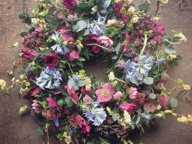 Spring flower garden funeral wreath, sympathy flowers in prety pinks and pale blues