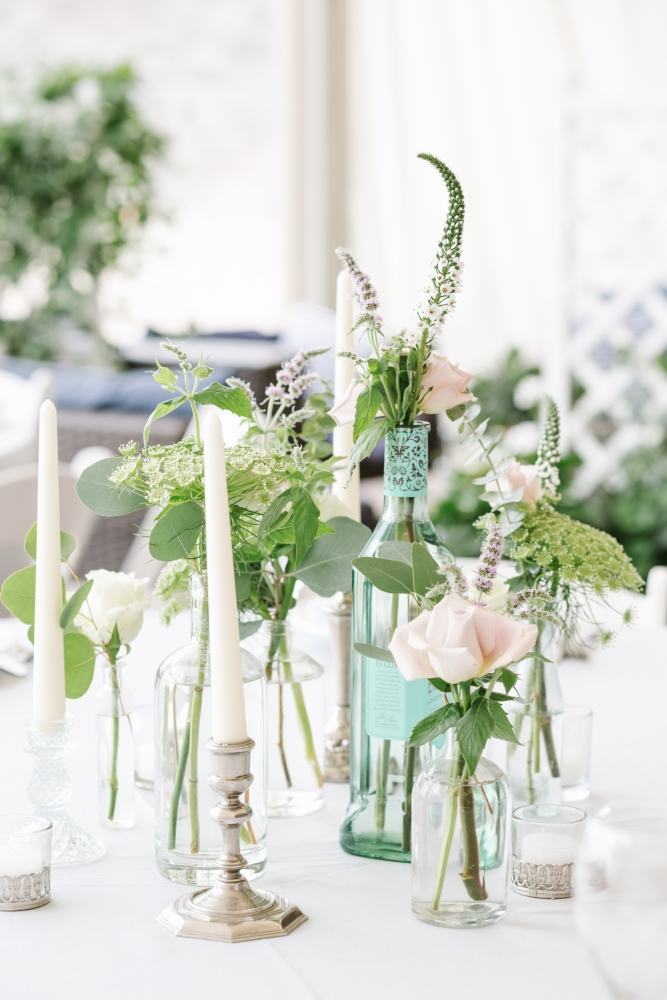 Gin bottle floral table centrepiece beach wedding cornwall