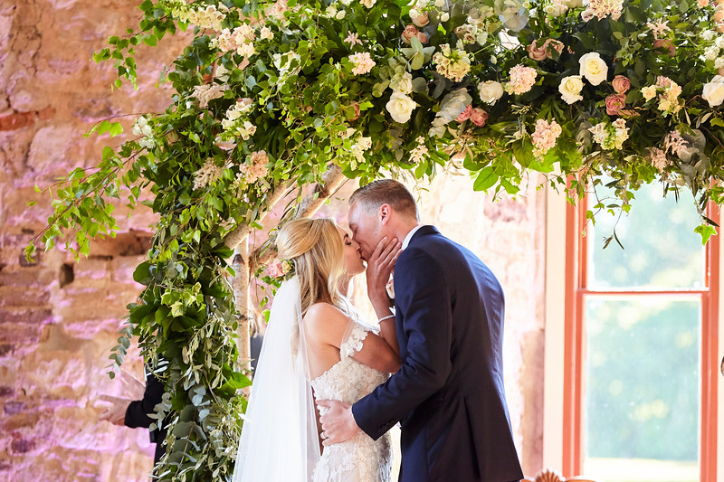 garden rose and foliage floral arch ceremony flowers lulworth castle