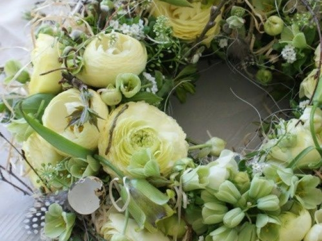 neutral textured garden flowers funeral wreath in whites and creams