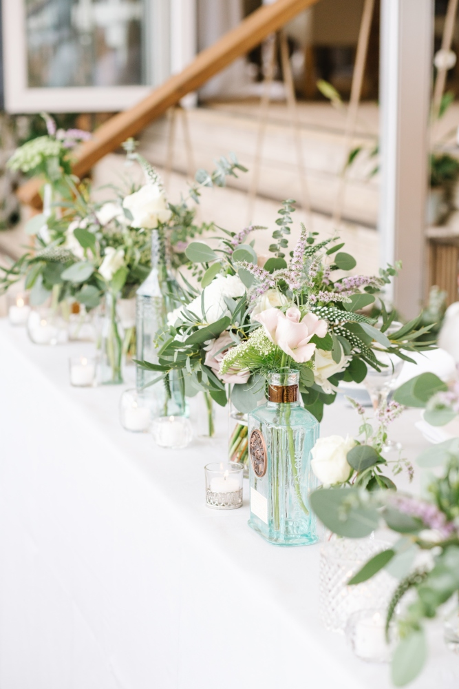 top table gin bottle beach wedding table centrepiece wedding flowers