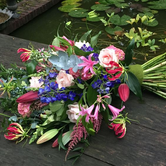 Tropical garden flowers pink tied sheaf, funeral flowers, sympathy flowers