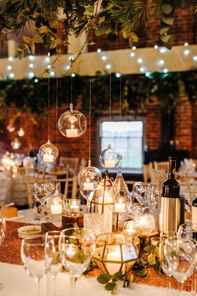 sopley mill winter wedding, cosy candle light table centrepiece, wedding flowers