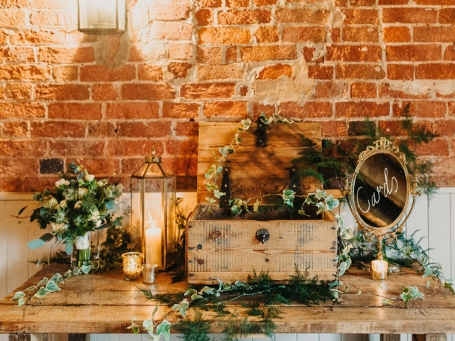 winter wedding sopley mill, gift table styling with foliage and candle light