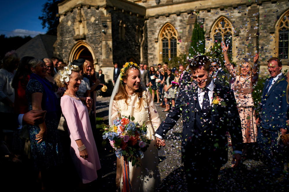 confetti shot Bride, floral crown, veil, wedding dress, bridal bouquet, wedding flowers, wedding florist, dorset hampshire, wiltshire