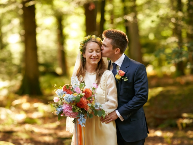 Bride and groom, woodland wedding,Bold, vibrant wedding flowers, bridal bouquet, orange dahlia, blue delphinium, wedding florist, dorset, hampshire, wiltshire