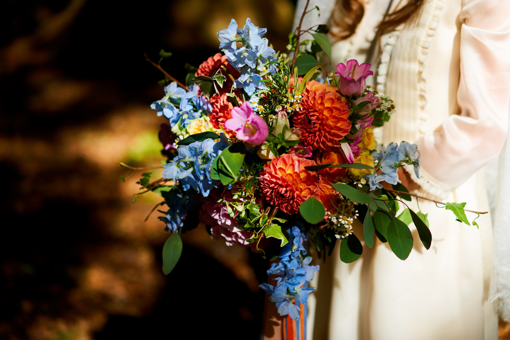 Bold, vibrant wedding flowers, bridal bouquet, orange dahlia, blue delphinium, wedding florist, dorset, hampshire, wiltshire