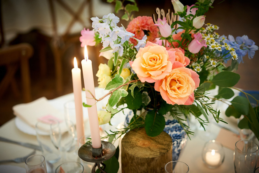 Table centrepiece, Bold, vibrant wedding flowers, orange dahlia, blue delphinium, wedding florist, dorset, hampshire, wiltshire